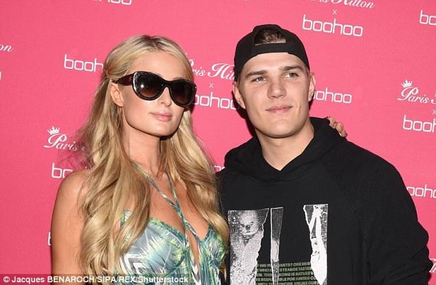 Support: Letting Paris take centre stage, Chris sported a backwards black baseball cap and oversized hoodie for the party