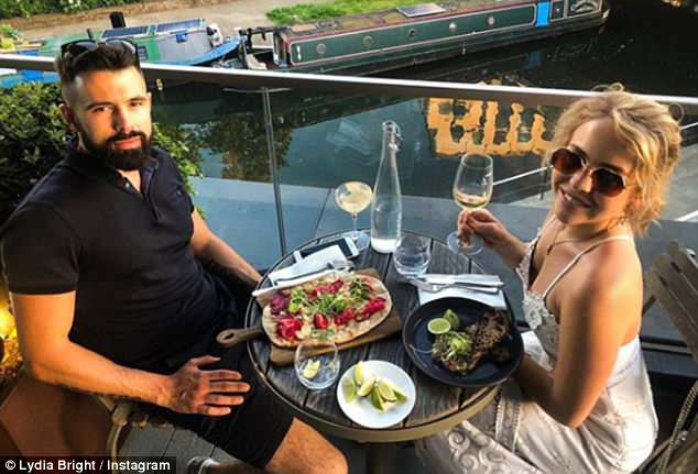 Happy days: Having kept their relationship quiet for a year, Lydia revealed: 'Lee is not from this world. We didn¿t expect it to happen. When we made it official, I said I didn¿t expect for him to come to events with me. Me and him live very normal lives, he¿s shy'