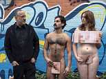 A group of courageous nudists have stripped off in freezing weather ahead of a controversial photoshoot on a Woolworths carpark rooftop (pictured is artist and photographer Spencer Tunich with nude models on Chapel Street, Melbourne)