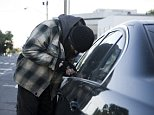 An obscure road rule could see you being fined $108 simply for not locking your car door (stock image)