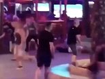 Trouble in paradise: Video footage shows British tourists fleeing for their lives as shots ring out on a busy party street in Benidorm, Spain