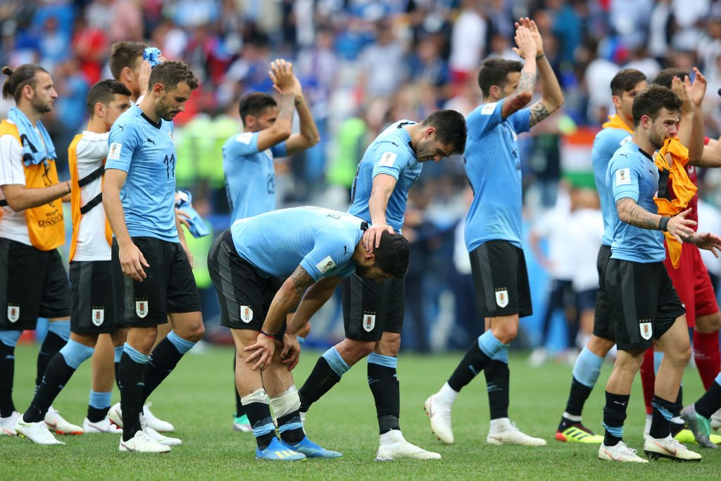 Uruguay walk off the pitch following defeat to France in the quarter-finals of the 2018 FIFA World Cup Russia™.