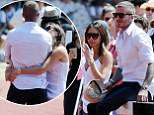 BGUK_1279092 - *PREMIUM-EXCLUSIVE* LONDON, UNITED KINGDOM  - *NO NOT USE UNLESS FEE AGREED*  *STRICTLY NO ONLINE UNTIL FURTHER NOTICE* David and Victoria Beckham enjoying the balmy British weather on a hot summers day in London. The Beckhams show their public display of affection for one another with Victoria putting her arms around David as the couple looked happy and relaxed attending a kids sports day event at Perivale Park Athletics Track. Pics taken: 03/07/2018 Pictured: David Beckham and Victoria Beckham BACKGRID UK 5 JULY 2018  UK: +44 208 344 2007 / uksales@backgrid.com USA: +1 310 798 9111 / usasales@backgrid.com *UK Clients - Pictures Containing Children Please Pixelate Face Prior To Publication*