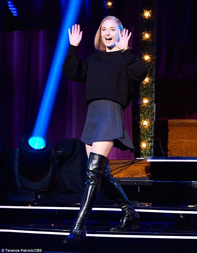 Kinky boots: For her London appearance, the Josie actress wore a black knit sweater, grey mini-skirt, and black thigh-high boots selected by stylist Elizabeth Saltzman