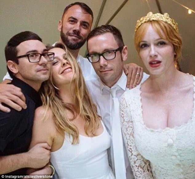 Friends: Christian (left) posed with (from left to right) Alicia Silverstone,John Halbach,Kit Williamson, and Christina Hendricks during the star-studded wedding bash