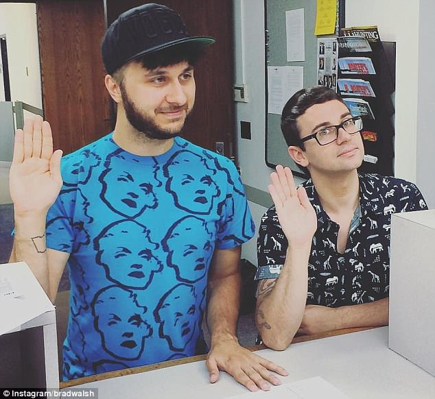 Paperwork: Brad previously shared this photo of himself and Christian 'solemnly swearing the information on [their] marriage license application is accurate'