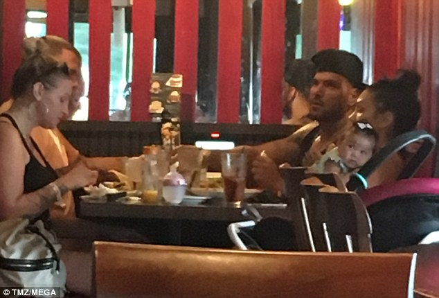 Reunited: Jersey Shore star Ronnie Ortiz-Magro was photographed eating with his estranged baby mama Jen Harley and their three-month old daughter Ariana at a restaurant in New Jersey on Thursday; Jen flew in from Las Vegas to spend July Fourth holiday with Ronnie