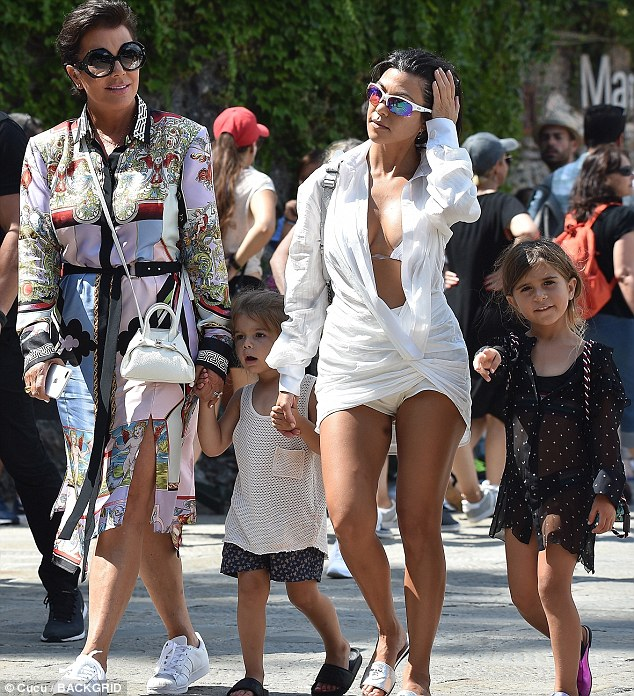 Happy group:The eldest daughter of Kris chose a thigh-grazing dress that had a plunging neckline, revealing a flash of cleavage as well as her toned midsection
