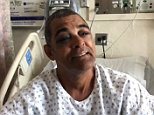 Michael Vansluytman, 59 (pictured in his hospital bed), said he was attacked on the New York City subway this weekend because he refused to give a homeless man money