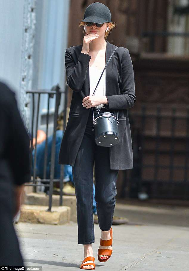Beautiful: The 29-year-old looked stylish in sleek black sandals and jeans, teamed with a large, black blazer