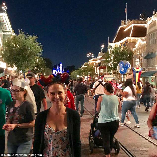 So much fun: Another image showed the actress wearing mouse ears as she enjoyed the evening at the park