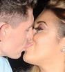 Sealed with a kiss: Big Brother stars Sam Chaloner and Ellie Young shared a steamy smooch outside the JSKY Fashion Event in London
