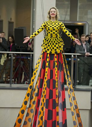 The world's longest designer dress, which measured a staggering 15 metres and was designed by Henry Holland was unveiled by model Colette Morrow as Trinity Leeds opened its doors