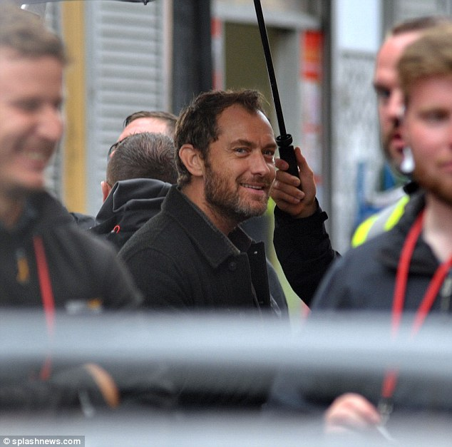 Back to work: Jude Law and Blake Lively put on brave faces in the rain on set for The Rhythm Section on Sunday
