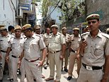 Five boys as young as nine gang-raped an eight-year-old girl in India after watching porn on a mobile phone, police say (file picture)