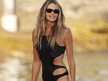 Disgraced doctor Andrew Wakefield should note that living – and dining – with supermodel Elle Macpherson is no picnic (pictured on a beach in Sydney earlier this year)
