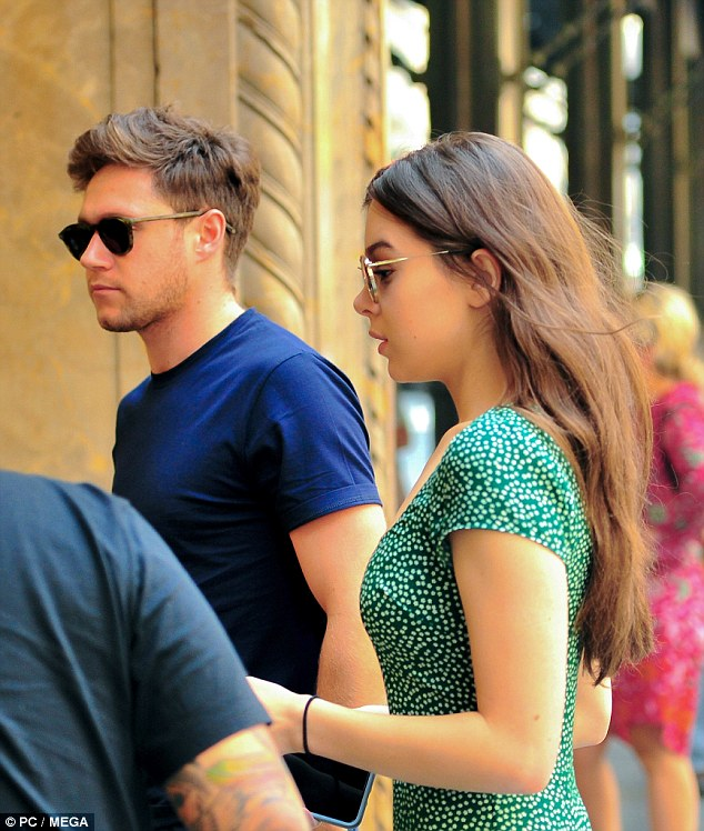 Flirty:The One Direction hunk sported a low-key navy ensemble while his 'girlfriend' kept it chic in a floaty green dress with delicate white spots graduated throughout