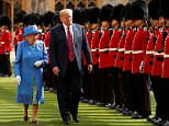 Donald Trump has falsely claimed the Queen reviewed her Honour Guard for the first time in 70 years during his Windsor visit. Pictured: The pair inspecting the guard on Friday