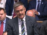 John Woodcock, who has been suspended over sexual harassment allegations, said the process against him was being 'manipulated for factional purposes'. He is pictured asking a question at PMQs today