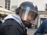 Alexandre Benalla, who is in his mid-30s, attacking two young protesters, including a woman (pictured)