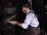 Miner with pick hewing coal underground in a coal mine. coal, underground, Coal, lying, age, underground, coal, underground, coal, Coal, lying, age, underground BFX8RM