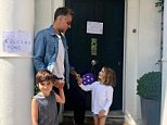 The Instagram post showed him smiling with his two children on the doorstep of his London home