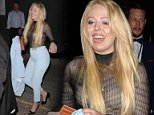 Tiffany Trump grabs the hand of her security detail to help her cross the street in London