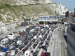 At the moment, British motorists can drive in the EU under their normal licences - but there is as yet no deal to keep mutual recognition in place. Pictured are holidaymakers queuing at the Ferry Port at Dover