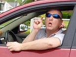 With the window of his car rolled down the man repeatedly hurls the N-word at the black driver