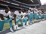 FILE - In this Sept. 11, 2017 file photo, from left, Miami Dolphins' Jelani Jenkins, Arian Foster, Michael Thomas, and Kenny Stills, kneel during the singing of the national anthem before an NFL football game against the Seattle Seahawks in Seattle. Miami Dolphins players who protest on the field during the national anthem this season could be suspended for up to four games under a new team policy issued to players this week. The policy obtained by The Associated Press on Thursday, July 19, 2018 classifies anthem protests as conduct detrimental to the club, punishable by suspension without pay, a fine or both. (AP Photo/Stephen Brashear, File)