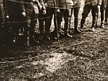 British Tommies stare at the imprint of a German officer who fell from a burning Zeppelin over Billericay, Essex, in 1916. This image is just one of dozens found in a collection of stereoscopic slides showing scenes from the First World War. The slides were designed to commemorate the war and presented in pairs, so they would appear 3D when seen through special glasses
