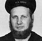 In this June 20, 1942 photo provided by the Naval History and Heritage Command, Howard Curtis, a U.S. Navy second-class aerographer, wears a seven-month's beard at Dutch Harbor, Alaska. Though the Navy said in July 2018, that its servicewomen could wear longer hairstyles, servicemen have not been permitted to wear beards, which were banned in 1984. (Naval History and Heritage Command via AP)