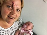 Claire O'Neill is pictured with her daughter Eliza after they were reunited in hospital following the theft of Ms O'Neill's car while the baby was still strapped in her car seat in the back