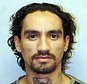 FILE - This undated file photo provided by the Hawaii Police Department shows Justin Joshua Waiki. Hawaii's entire Big Island police force was on alert Wednesday, July 18, 2018, for the suspect wanted in the killing of Hawaii County police officer Bronson K. Kaliloa during a traffic stop, including off-duty officers and some who returned to work from vacation and days off to join in the search. (Hawaii Police Department via AP, File)