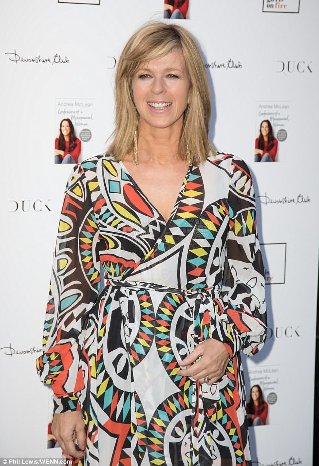 Standing out: Showing off her trim figure, Kate Garraway opted for a heavily printed wrap style dress