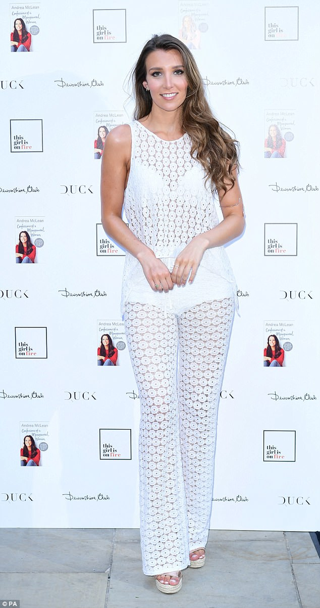 Looking good: Lucy Kane showed off her slender figure in a semi-sheer white cut-out number which teased at her bra
