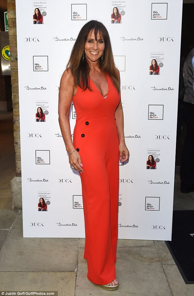 Orange you glad to see her? Linda Lusardi made a bright and colourful statement in a colourful orange dress which perilously plunged down the middle