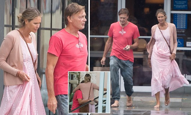 Moving in together? Elle Macpherson shops for furniture with controversial new boyfriend