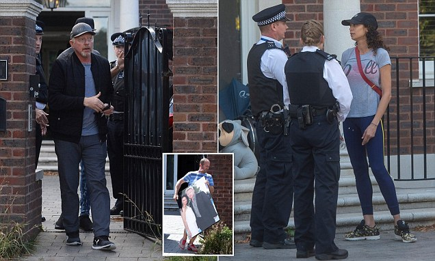 Lilly and Boris Becker are pictured talking to police at £5m home