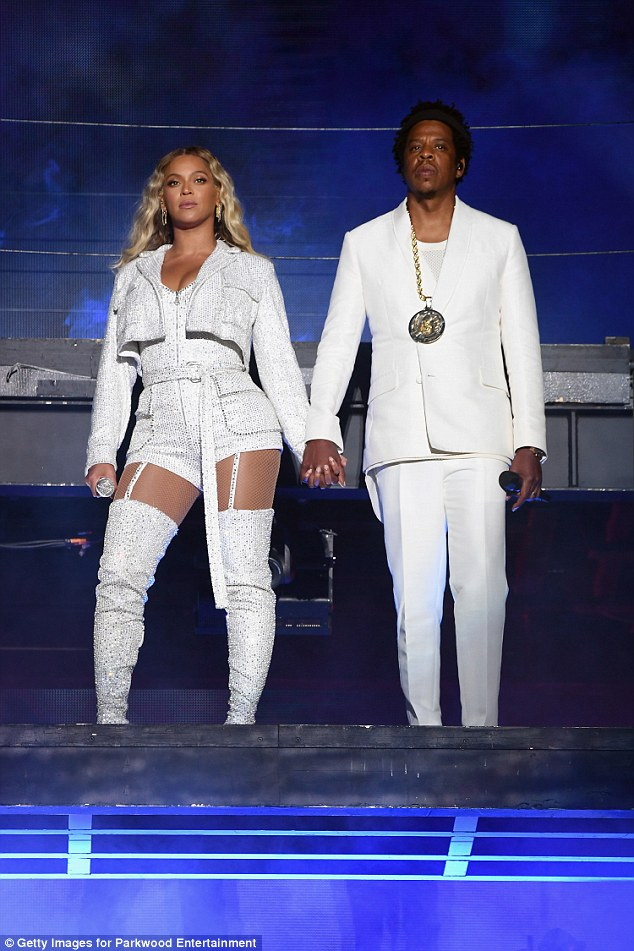 The main attraction: The Obamas were watching Beyonce and Jay Z's On The Run II tour