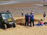 A father who dug a hole for his four-year-old son to play in was told to fill it in by beach safety officers after members of the public complained