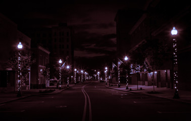 Glowing Downtown Street At Night