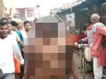 A woman was stripped naked, beaten and paraded through the streets by a mob in India