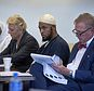 FILE - In this Aug. 29, 2018, file photo, Jany Leveille, from left, with her attorney Kelly Golightley, and Siraj Ibn Wahhaj with attorney Tom Clark listen to the prosecutor during a hearing on a motion to dismiss in the Taos County Courthouse. Federal prosecutors say the FBI has arrested five former residents, including Leveille and Wahhaj, of a ramshackle compound in northern New Mexico on firearms and conspiracy charges as local prosecutors dropped charges in the death of a 3-year-old boy at the property. Taos County District Attorney Donald Gallegos said Friday, Aug. 31, his office will now seek grand jury indictments involving the death. (Eddie Moore/The Albuquerque Journal via AP, Pool, File)
