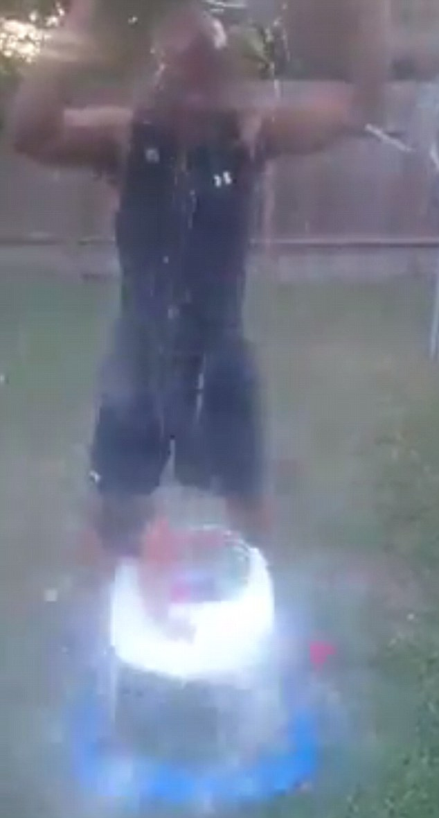 The little girl was drenched by the freezing water in the clip which was posted on Facebook. One stranger reportedly sent the link to the video to child services