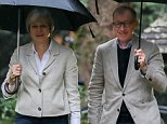 Theresa May has furiously dismissed questions about whether her husband Philip (pictured together in Maidenhead on Sunday) has an influence over her policies as a 'sounding board'