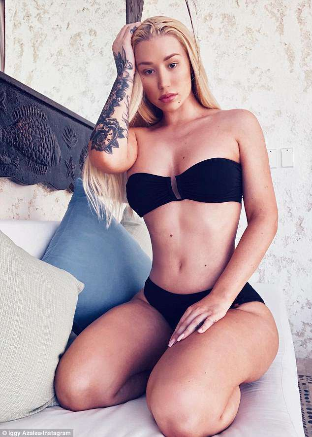 'I'm still cleaning up the mess now': Iggy Azalea has revealed she got professional help for mental health issues at a 'retreat' after her management staged an intervention