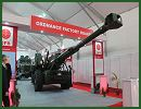 Ordnance Factories Board (OFB) of India presents the latest prototype of its 155mm 45 calibre Dhanush towed howitzer at Defexpo 2014, the International Defense Exhibition of New Delhi, India. OFP is an industrial setup functioning under the Department of Defence Production of Ministry of Defence, Government of India.
