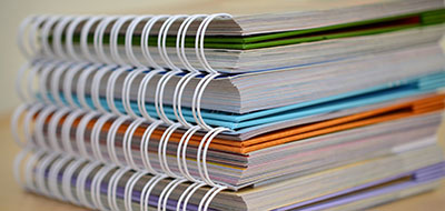 a stack of spiral-bound documents