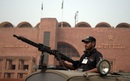 A policeman guards the Gaddafi Stadium, Lahore, October 28, 2017